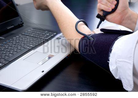 Businessman Measuring His Blood Pressure