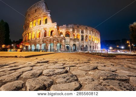 Rome, Italy. Colosseum Also Known As Flavian Amphitheatre In Night Time.