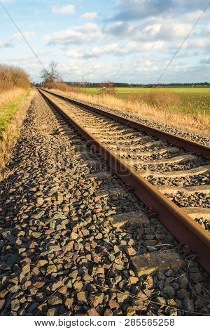 Rusty Single-track Train Tracks In A Rural Area In North Brabant, Netherlands. It Is At The End Of A