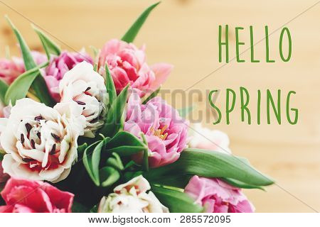 Hello Spring Text Sign On Beautiful Double Peony Tulips Bouquet In Vase On Wood. Springtime. Stylish