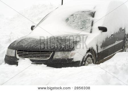 An European car in deep snowbank . poster