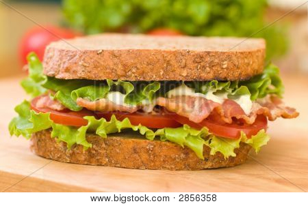 Blt Sandwich On A Wooden Cutting Board