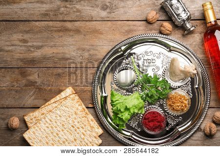 Flat Lay Composition With Symbolic Passover (pesach) Items On Wooden Background, Space For Text