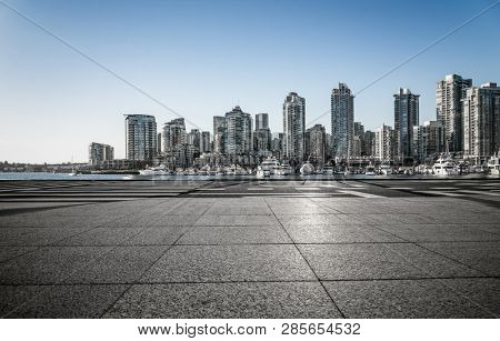 empty parking lot with downtown vancovuer, canada.