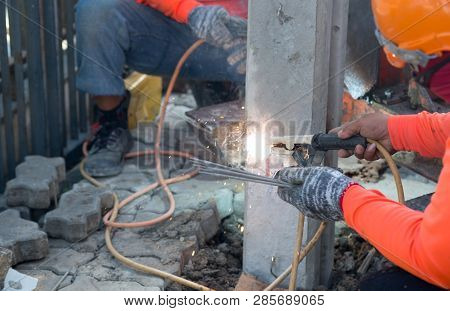 Construction Worker With Small Piling, Concrete Foundation Pile Head (micropile), Hammered Into The