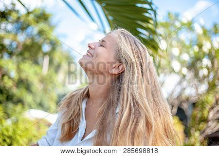 Beautiful Young Happy Blonde Girl With Long Hair In The Summer Spring Park, Perfect Face And Hare