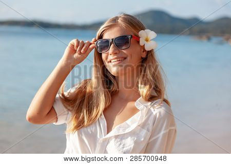 Beautiful Girl In Sea Style Tropical Sea. Travel And Vacation. Freedom Concept. Sensual Blonde Beaut