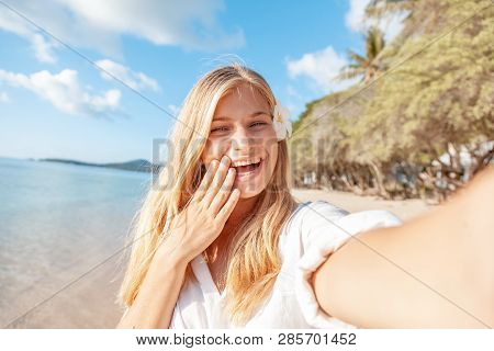 Travel Vacation Tourist Blonde Teen Girl Selfie Photo With Phone On Tropical Holiday.  Summer Vacati
