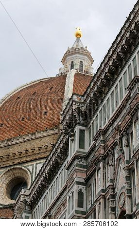 Huge Dome Of The Cathedral Designed By The Architect Brunelleschi And The Great Golden Sphere On The