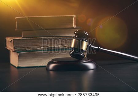Law Concept - Open Law Book With A Wooden Judges Gavel On Table In A