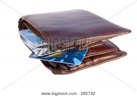 Old Wallet With Credit Cards Inside, Isolated On White Backgroun