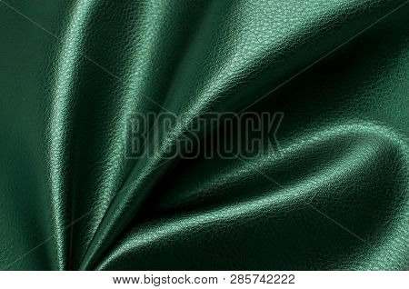 Green eco leather. Artificial leather. Synthetic leather. Leatherette background. poster