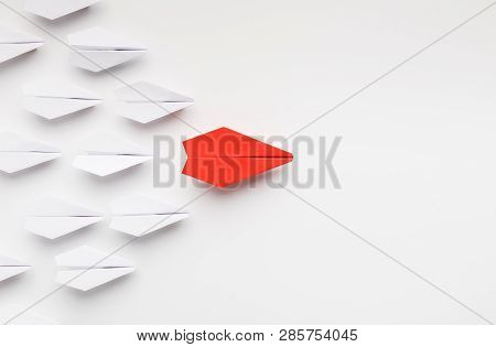 Opinion Leadership Concept. Red Paper Plane Leading Another Ones, Influencing The Crowd, White Backg