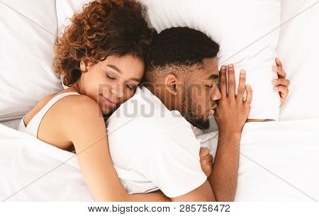 Sweet Dream. Millennial African-american Couple Cuddling, Sleeping Closely In Bed