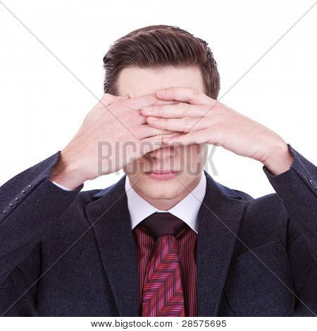 business man making the see no evil gesture over white