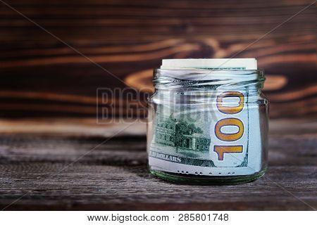 Saving Money In Jar With American Dollars , Cash