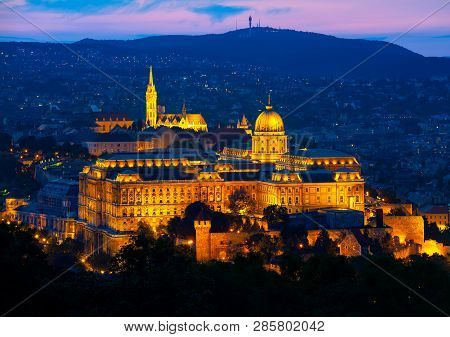 Illuminated Budavari Palace In Budapest At Summer Sunset