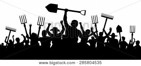 Angry Peasants Protest Demonstration. A Crowd Of People With A Pitchfork Shovel Rake. Riot Workers V