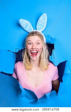 Happy Easter! Bunny Ears. Woman Through Paper. Happy Woman Looking Through Paper. Egg Hunt. Easter.