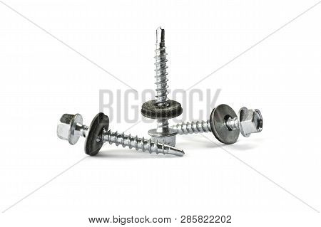 Closeup Self Drilling Screws For Roofing With A Drill And With Sealing Washer Isolated On White. Iso