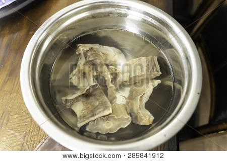 Nigerian Stockfish or Panla soaked in water for easy cooking poster