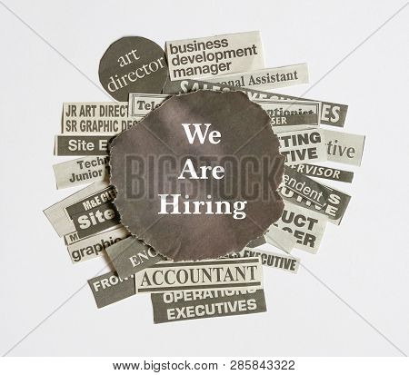 Job Opportunity Concept- Job Titles Or Vacancies Cut From Newspapers On White With Text, We Are Hiri