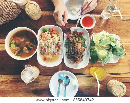 Top View Thai Food On Table: Eating North Eastern Foods (som Tum - Spicy Papaya Salad, Sticky Rice,