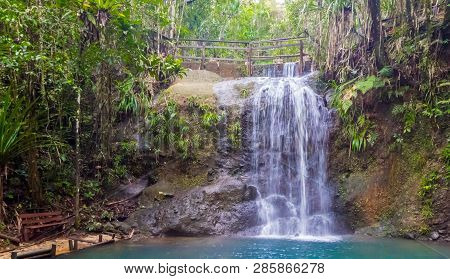 A Bench At The End Of Hiking Trail To Enjoy A Waterfall In Colo-i-suva Rain Forest National Park, Na