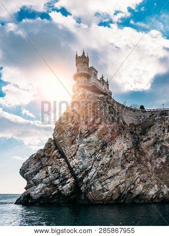 Ancient Castle On Cliff Of Crimea Seashore Shallow Nest, Famous Tourist Place Of Yalta.