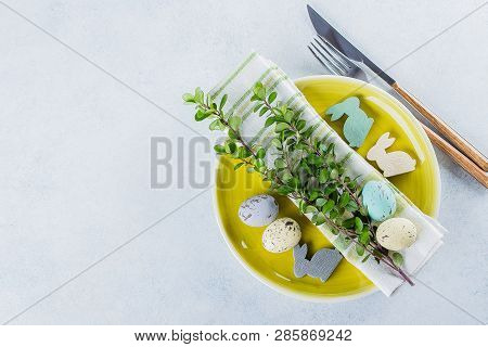 Festive Table Setting For Holiday Easter Dinner On Light Concrete Table With Copyspace. Spring Holid