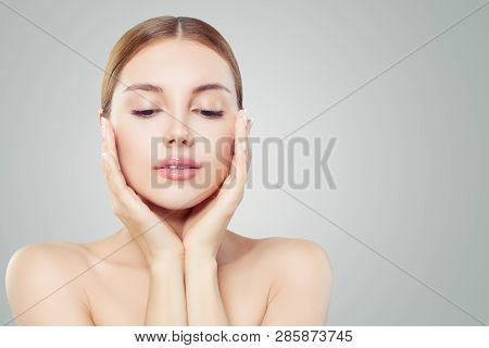 Perfect Woman Face. Beautiful Girl Touching Her Face Her Hands. Facial Treatment, Face Lifting, Anti