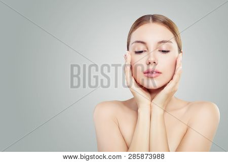 Beautiful Face. Pretty Woman Holding Her Face In Her Hands. Facial Treatment, Face Lifting, Anti Agi