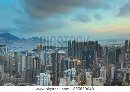 Cityscape view with condos and office buildings and sun beam poster