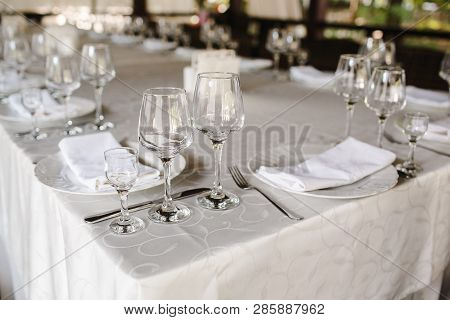 Crystal Dishes On A Restaurant Table, Open Background.
