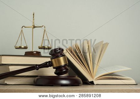 Law Concept. Wooden Judge Gavel With Law Books , Scales Of Justice On Table In A Courtroom Or Enforc