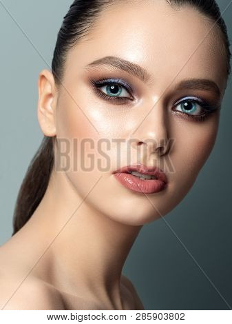 Portrait Of Young Woman With Beautiful Makeup. Youth Makeup Concept. Studio Shot