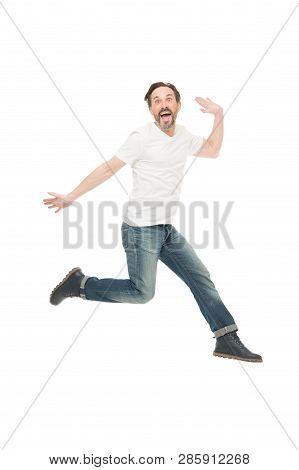 Free Jumping. Having Fun. Mature Man Jumping In Fun. Funny Man. Mature Man Of Fashion With Grey Bear