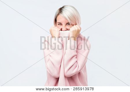 A Girl With A Social Phobia Hides Her Face In A Sweater.