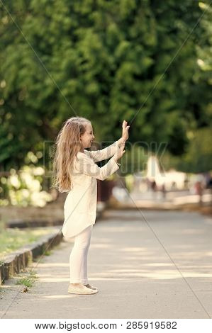 Small Child With Long Hair Play Outdoor. Happy Girl In Summer Park. Fashion Kid Have Fun. Summer Act