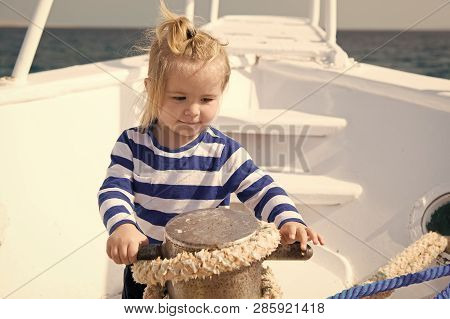 Baby Concept. Cute Baby Sailor. Little Baby Travel On Ship In Sea. Baby On Summer Vacation.