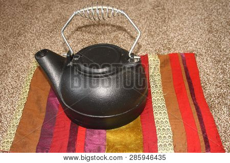 A Cast Iron Tea Kettle, Was Probably Used Over Open Fires, In Fire Places And Old Wood Cook Stoves.