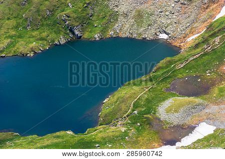 Summer Time In Romanian Carpathians. Beautiful Scenery Of Fagaras Mountains. Lake Capra View From Ab