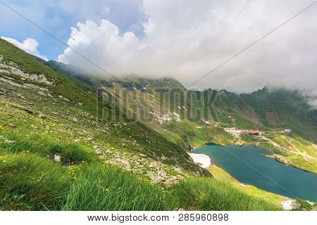 Summer Time In Romanian Carpathians. Beautiful Landscape Of Fagaras Mountains. Lake Balea Down In Th