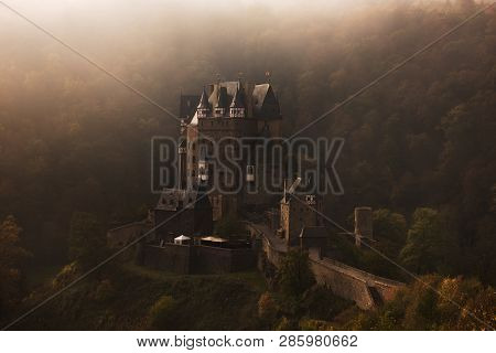 The Medieval Burg Eltz Castle, With Half-timbered Towers, Like In A Fairy Tale, Built Upon A Rock In
