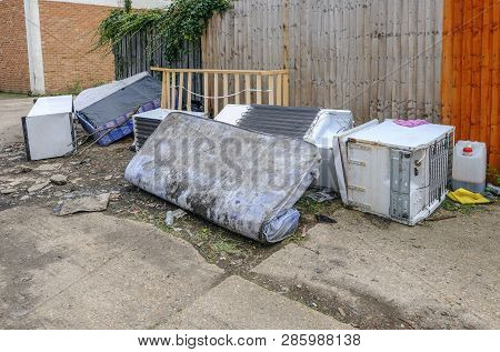 Large Kitchen Items Dumped In An Alleyway.  Fridge, Freezer And Matress. Fly Tipping Is An Anti-soci