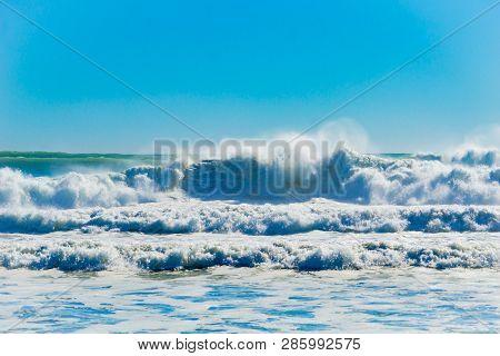 Turbulent sea at Mount Maunganui Main Beach,  Tauranga New Zealand poster