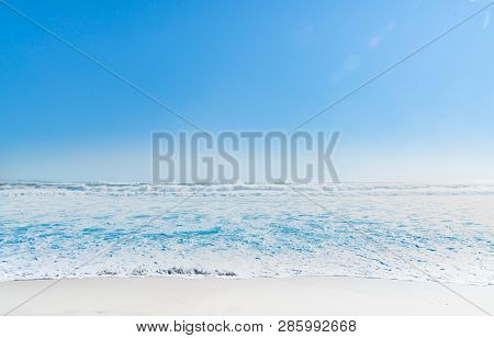 Turbulent sea during strong ocean surge as summer image with copy space or for background poster