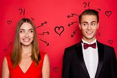 Closr-up portrait of two nice chic lovely attractive imposing cheerful funny flirty people wearing dress and bow tux looking at each other thinking isolated over bright vivid shine red background poster