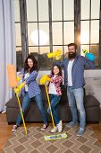 Family mom dad and daughter with cleaning supplies at living room. We love cleanliness and tidiness. Cleaning together easier and more fun. Family care about cleanliness. Start cleaning. Cleaning day. poster