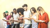 Multiracial friends using mobile smartphone at university coampus - Millenial people addicted by smart phones - Tech concept with always connected millennials on social networks - Bright warm filter poster